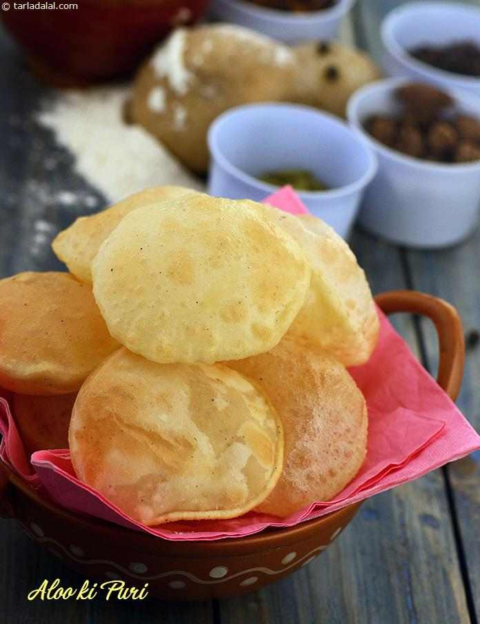 Aloo Ki Puri is fluffy and sumptuous . A unique combination of saffron and pepper play out like a soft, enchanting tune in aloo ki puri, but if you'd like more punch, dash it up with crushed cumin seeds, green chillies and coriander leaves.