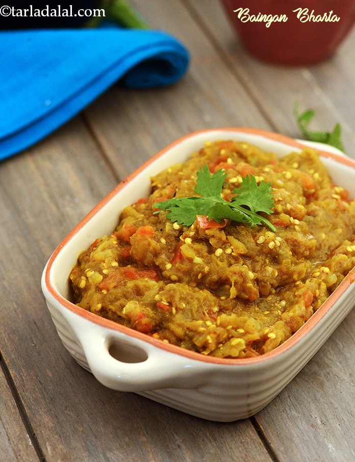 Baingan Bharta, toasted, peeled and mashed brinjals cooked along with tangy tomatoes and pungent ingredients like onions, ginger and green chillies.