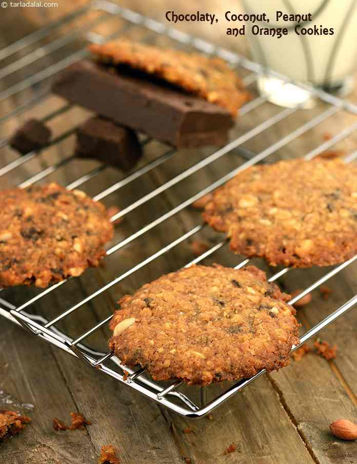 Chocolaty, Coconut, Peanut and Orange Cookies, using brown sugar imparts an intense flavour to the cookies, while rolled oats give it a nice and coarse texture. Coconut and peanuts dominate these cookies, which are neither too crisp not too soft.
