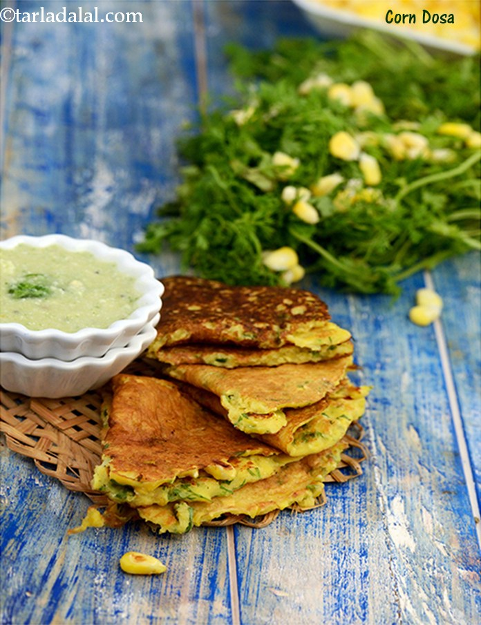 Corn Dosa, made with fresh sweet corn kernels, a little  besan for binding and green chillies and coriander for flavour, are of a perfect colour and texture. The best part is that the Corn Dosa can be made in no time at all.