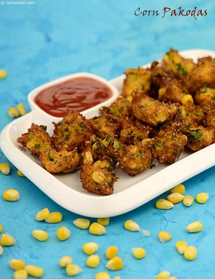 Crispy but soft Corn Pakodas made from a mixture of grated corn, coriander and green chillies.