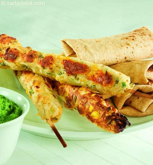 How to make Cheesy Seekh Kabab - Cheese mixed with chicken mince and masalas, wrapped around satay sticks and grilled