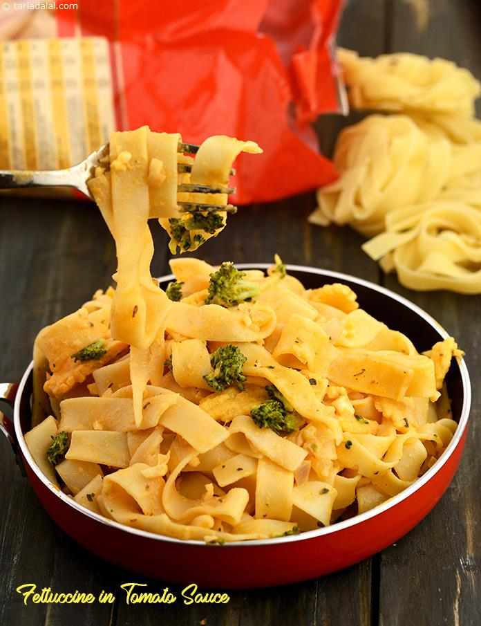 Fettuccine in Tomato Sauce, the oregano-flavoured tomato sauce is the highlight of fettuccine with tomato sauce, not to forget the thoughtful combination of broccoli and baby corn.
