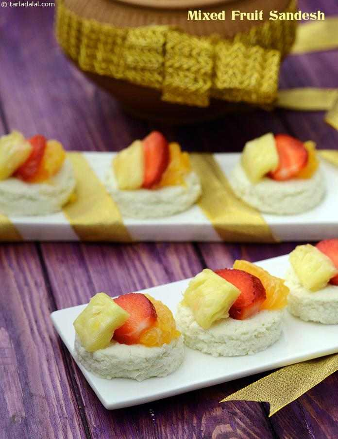 Using paneer and icing sugar enables you to prepare this popular Bengali favourite within minutes, while kewda essence gives it a traditional flavour and aroma. Topping with fresh fruits makes the Mixed Fruit Sandesh a refreshing dessert.