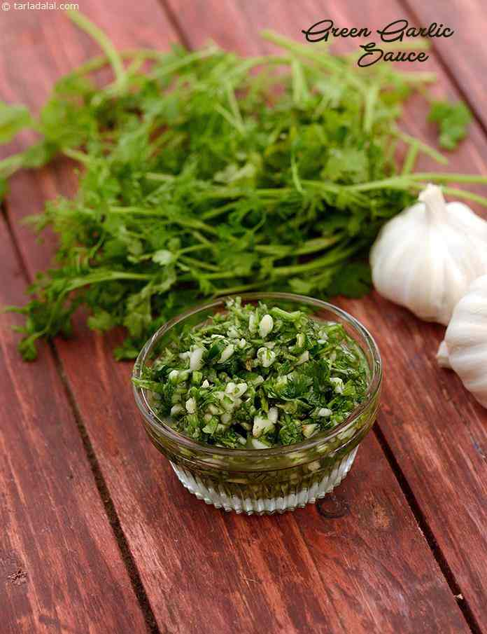 This tongue tickling Green Garlic Sauce is a refreshing combination of coriander, garlic, green chillies and vinegar.