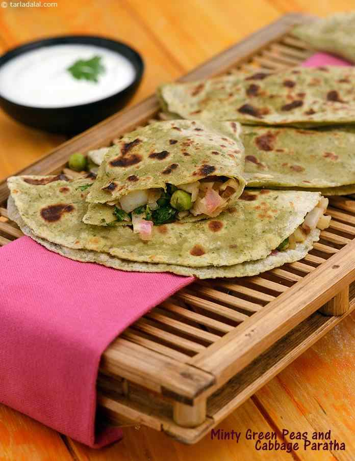 Green Peas, Cabbage and Potato Paratha,  a unique variation of the common phudina paratha. Stuffed with loads of veggies to create a truly gourmet indian dish.