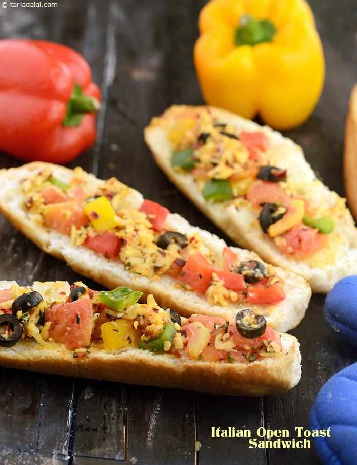 Italian Open Sandwich is a delicious Italian recipe of an open sandwich baked to perfection with a topping of cheese, olives and tomatoes.