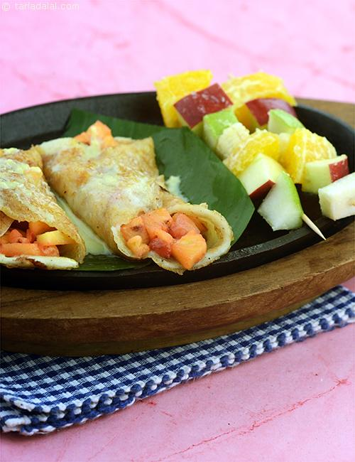 Malpua Rabdi Sizzler, sumptuous malpuas filled with seasonal fruits and topped with creamy rabadi that's made in a jiffy. You can substitute the seasonal fruits with any one fruit of your choice like mango, strawberries etc.