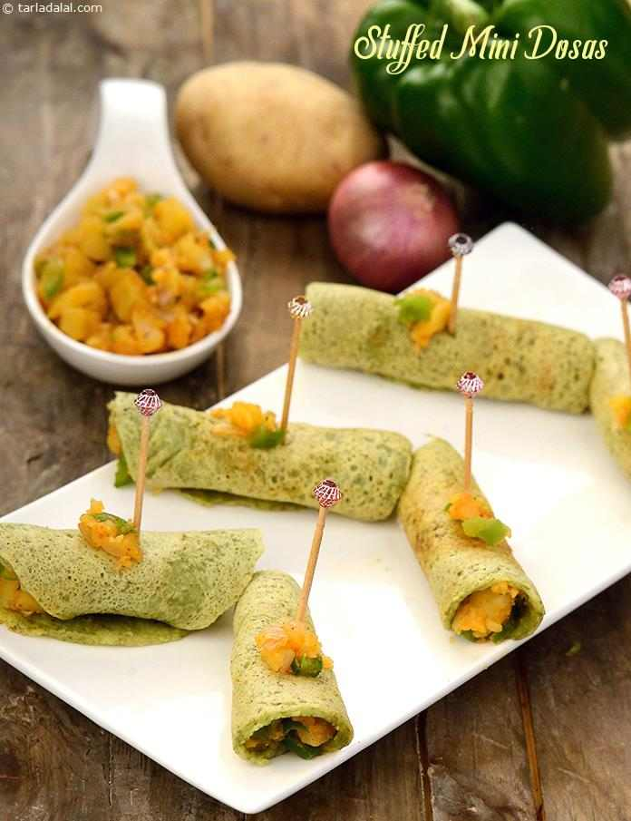 The mini dosas are conveniently made of a green gram based batter. To add to the crispy excitement of these dosas, they are stuffed with a succulent potato and capsicum mixture, which makes this handy-sized snack a thrilling mouthful indeed!