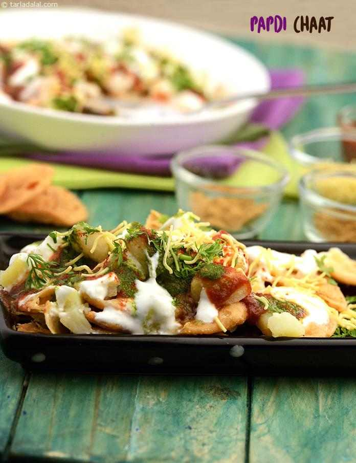 Papdi chaat as the name suggests has lots of papdis, tossed in a blend of chutneys, curds and potatoes. Mix the papdis, chutneys and curds the way you want.