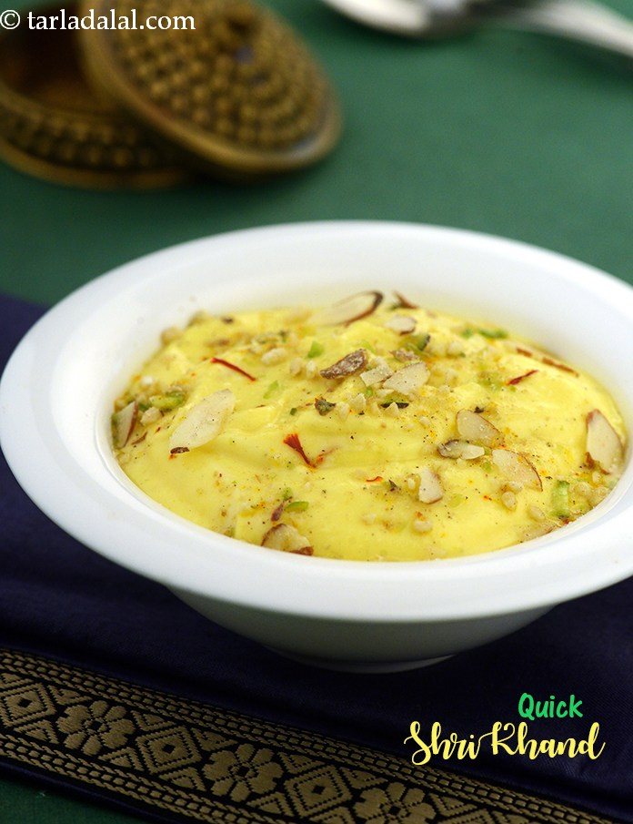 Quick Shrikhand, a dollop of gooey, creamy shrikhand laced with saffron and elaichi, topped with mixed nuts, and served with steaming hot puris.