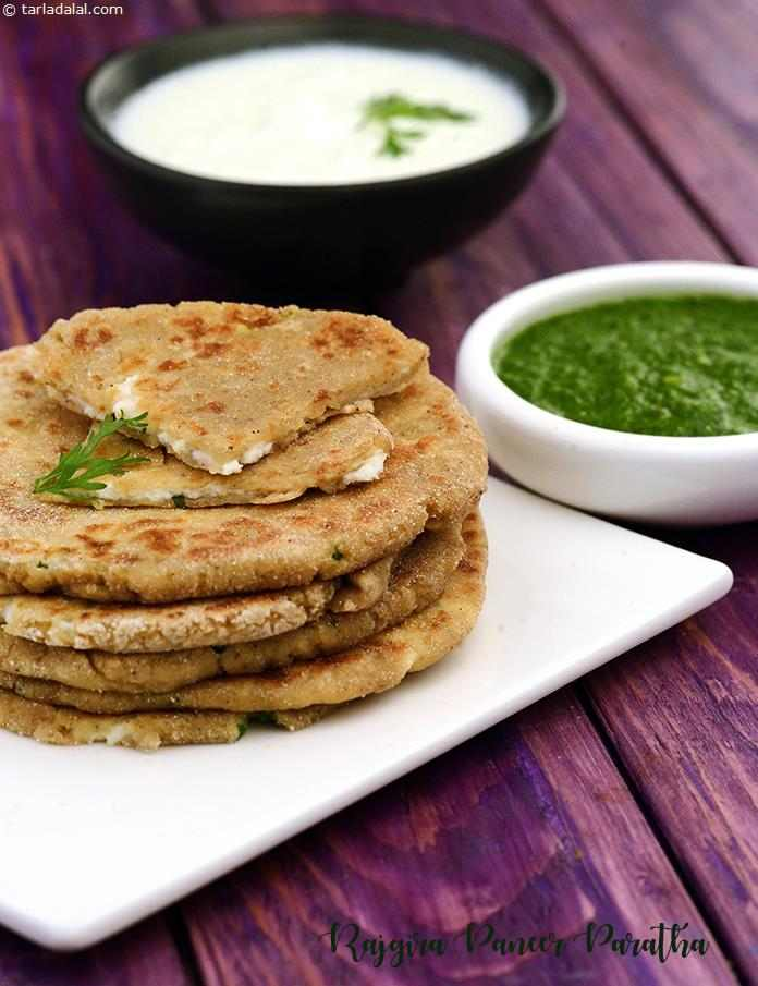 Here, wholesome Rajgira Parathas are stuffed with a succulent mixture of grated paneer perked up with green chillies, lemon juice and coriander.