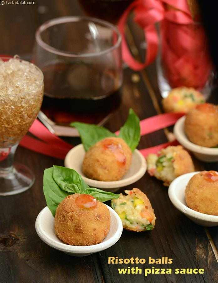 A mixture of rice, cheese, herbs and capsicum is rounded into balls, dipped in a flour batter and deep-fried into delicious Risotto Balls, which are crisp outside and delightfully gooey inside.