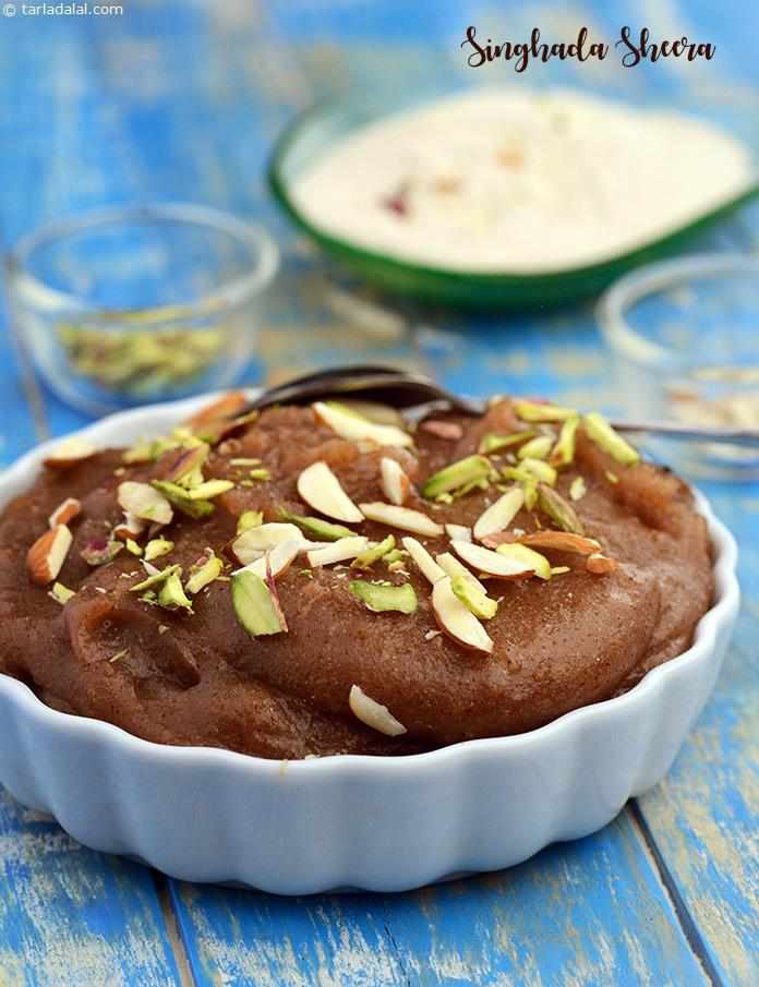 Singhada Sheera , the use of ghee and the addition of cardamom powder give the sheera a very rich aroma, typical of most Indian sweets. Garnish generously with nuts, to add to the sumptuousness of this delightful dessert.