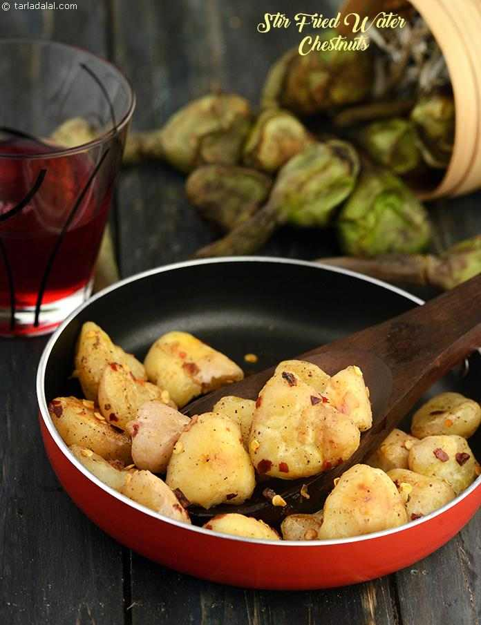 For water chestnut lovers this is the best way to eat them clean and healthy as they are stir fried in olive oil with garlic and chilli flakes. The garlic and chilli flakes coat the water chestnuts really well to give a nice garlic flavor.