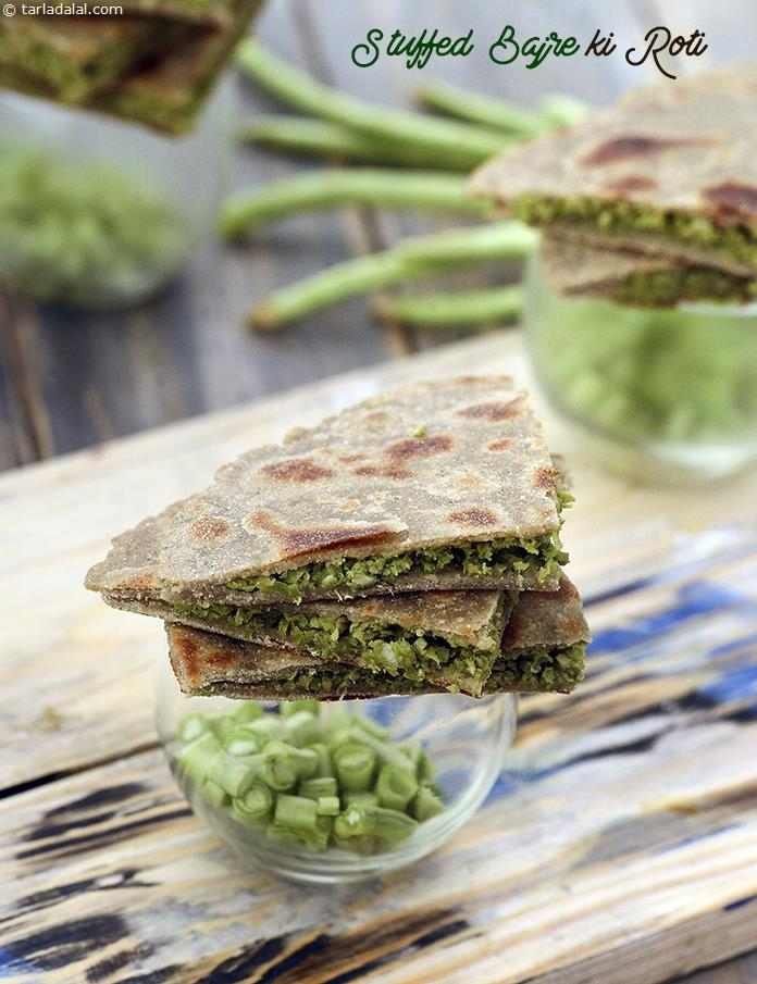 Stuffed Bajre Ki Roti packed with chopped chawli flavoured with green chillies and garlic. This innovative filling not only enhances the flavour of the bajra rotis, it also imparts the necessary softness making the rotis very palatable.