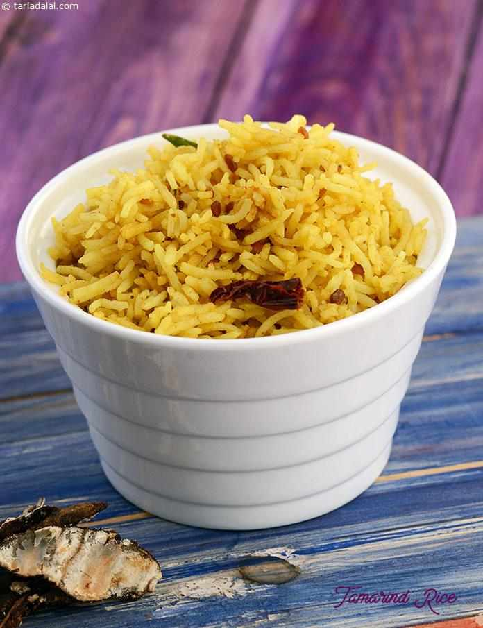 Tamarind Rice, a heart-warming dish that uses tamarind to create a magical flavor. The South Indian style tadka adds both flavor as well as appeal, making this a great lunch/dinner recipe.