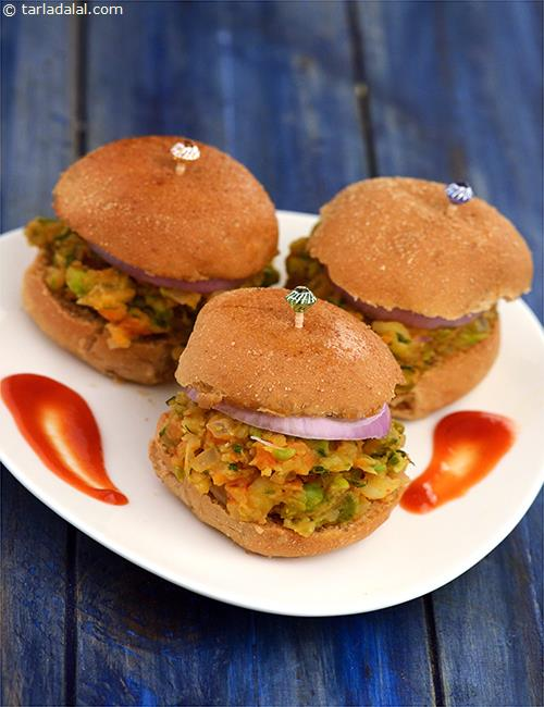 Tasty Pav Bhaji Burgers, spicy bhaji made of potatoes, tomatoes, peas and onions is filled in between burger buns, and topped with onion rings and baked until they are warm. Tastes delicious with a cup of hot tea!